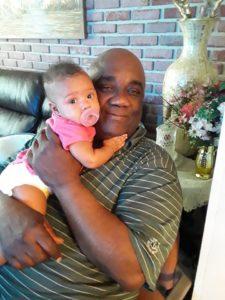 Mr. Benjamin and granddaughter in family photo